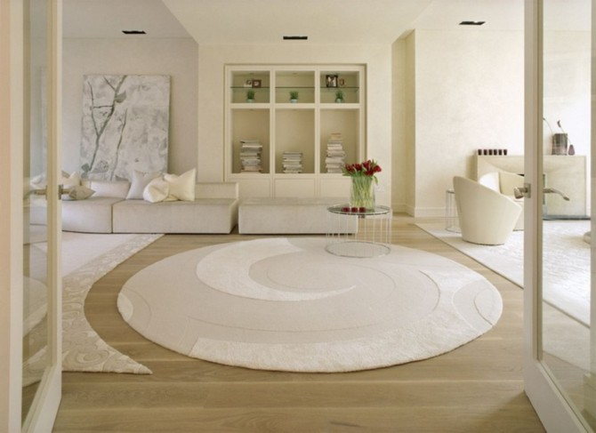 Tips on when you should use white contemporary rugs contemporary rugs How you should use white contemporary rugs luxury white large round rugs applied on the wooden floor it also has wooden shelves that can add the beauty inside room with white sofas make it seems nice