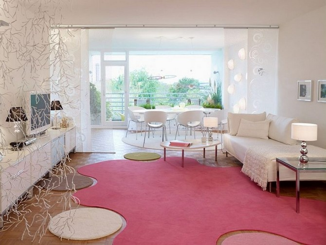 Keep it bold: follow the Summer trends using Pink Rugs! pink rugs Keep it bold: follow the Summer trends using Pink Rugs! white living room white chairs glass side table irregular shaped pink rug white day bed white chest tv stand metal lamp shade