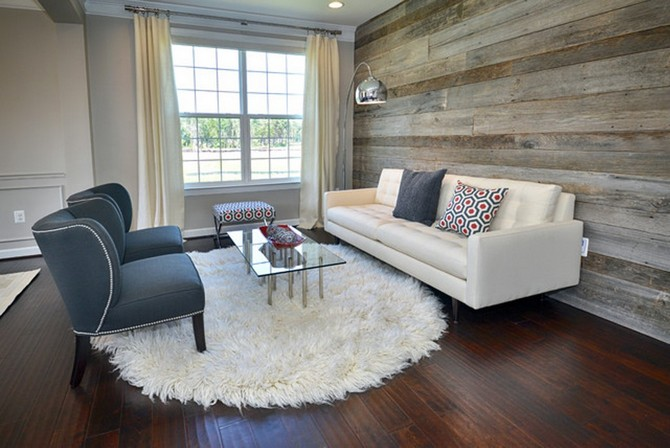 Learn How to Use Round Rugs in Your Decoration round rugs Learn How to Use Round Rugs in Your Decoration White Round Fur Rug for Small Living Room Design with White Couch and Grey Colored Hardwood Wall Decor