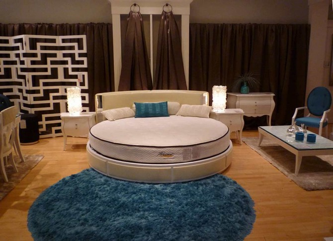 Top 10 Contemporary Rugs Part II contemporary rugs Top 10 Contemporary Rugs - Part II awesome bedroom with round white bed and round blue fluffy fur rug also twin white bedside table plus white coffee table and brown fabric curtain